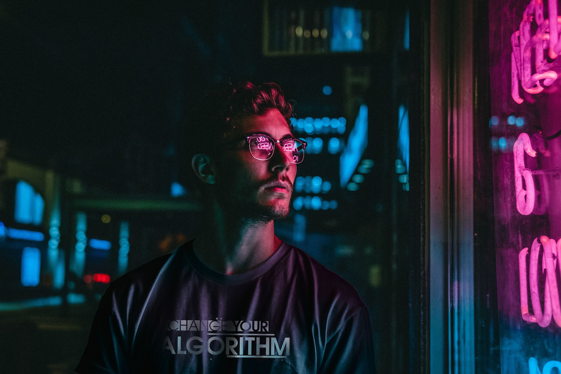 male staring at neon sign